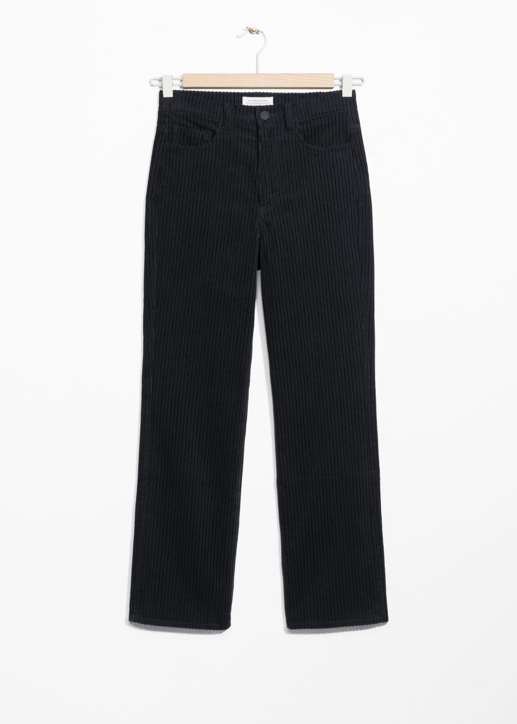 Front image of Stories cropped corduroy trousers in black