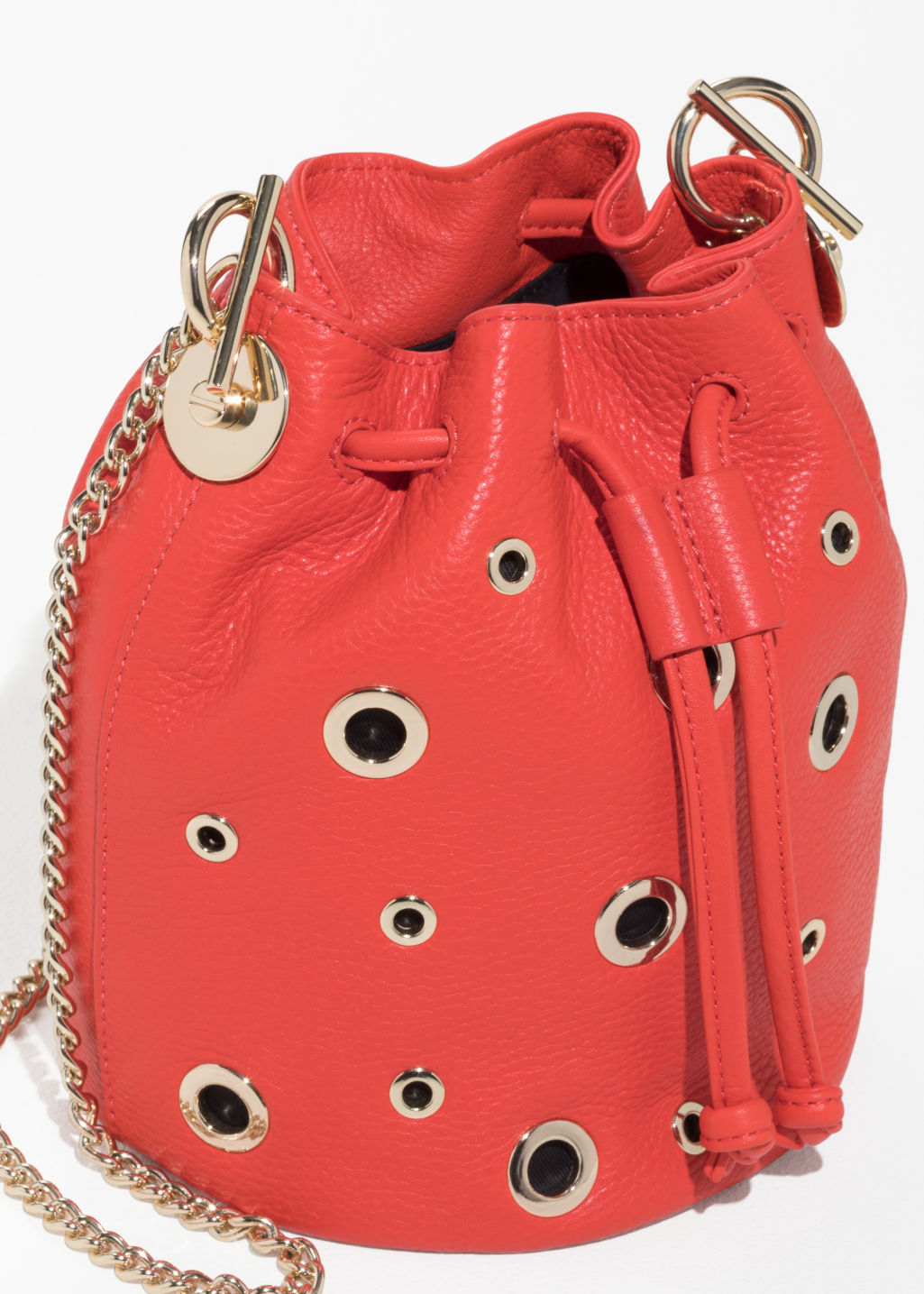 Back image of Stories grommet bucket bag in orange