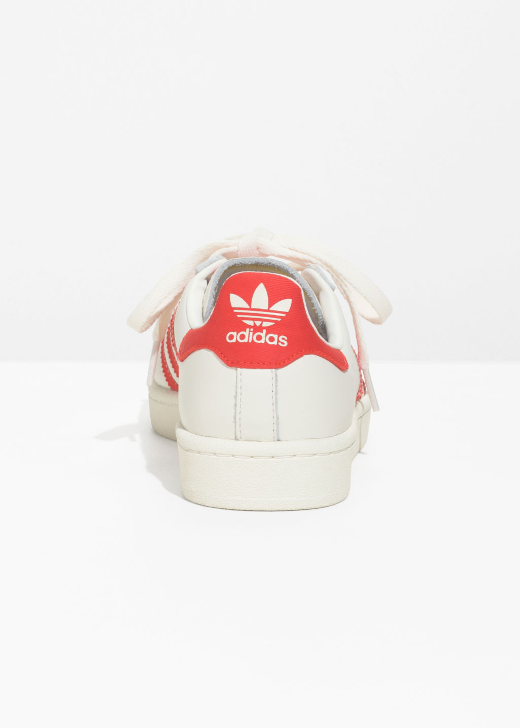 Back image of Stories adidas campus sneakers in white