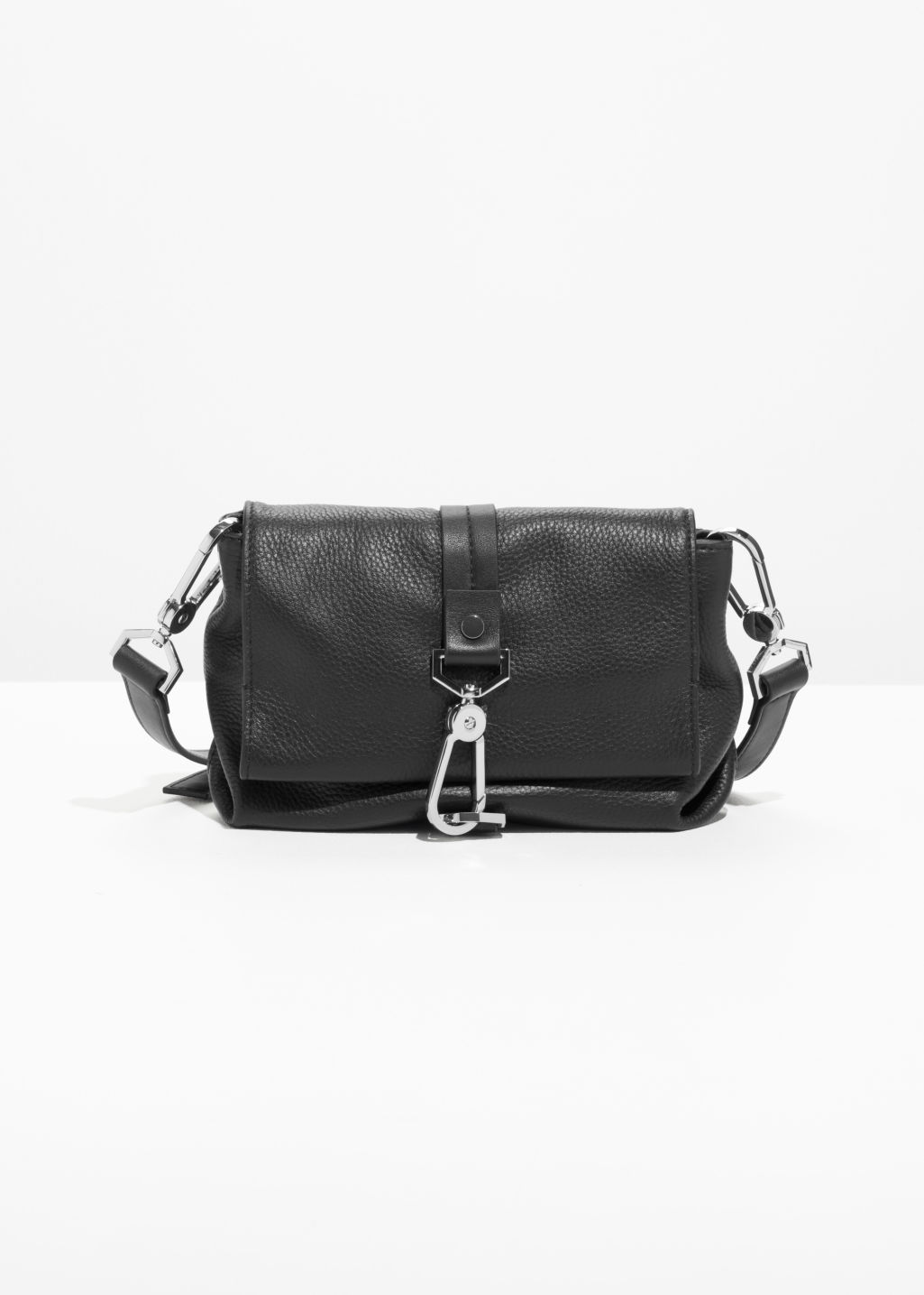 Front image of Stories mini leather buckle crossover in black