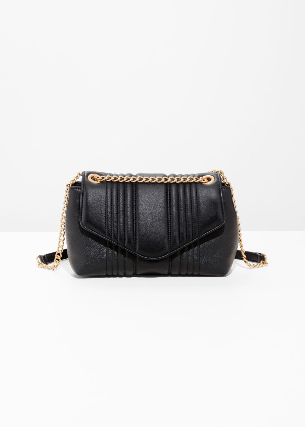 Front image of Stories curved chain handbag in black