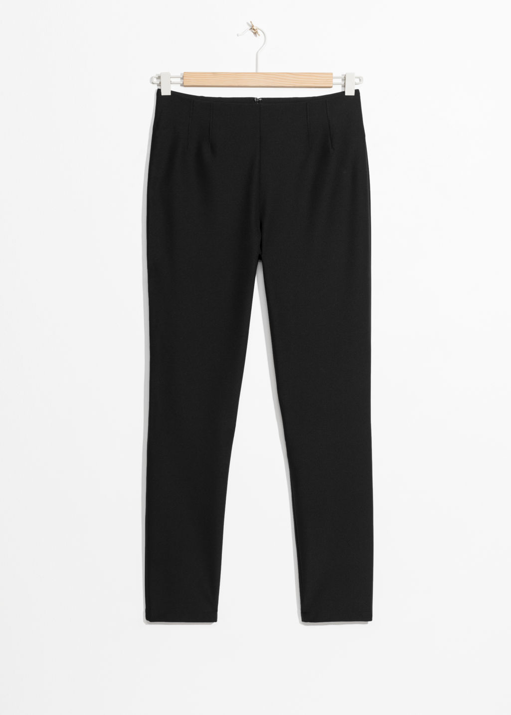 Front image of Stories slim fit legging trousers in black