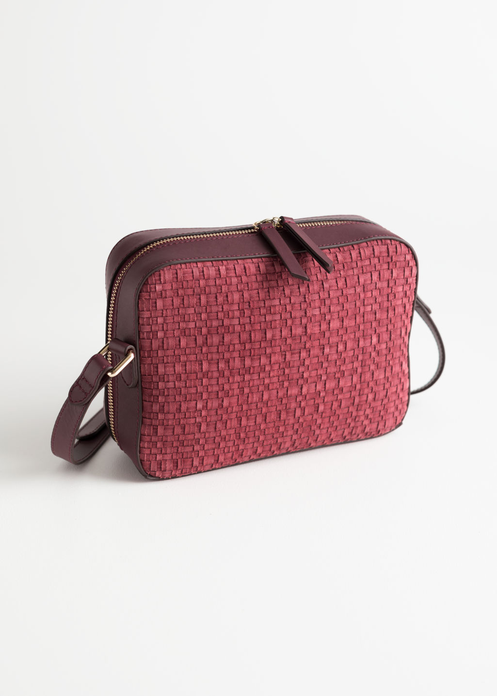 Front image of Stories braided suede crossbody bag in red
