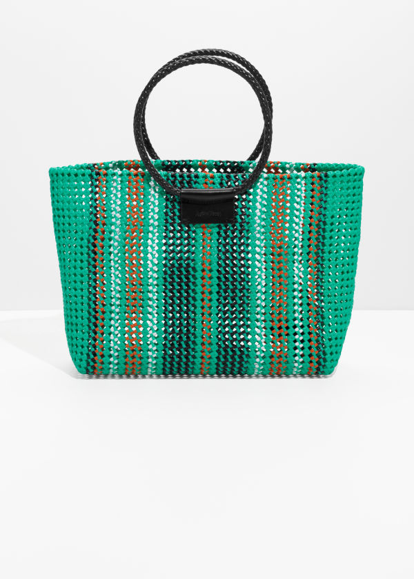 Front image of Stories woven plastic tote in green