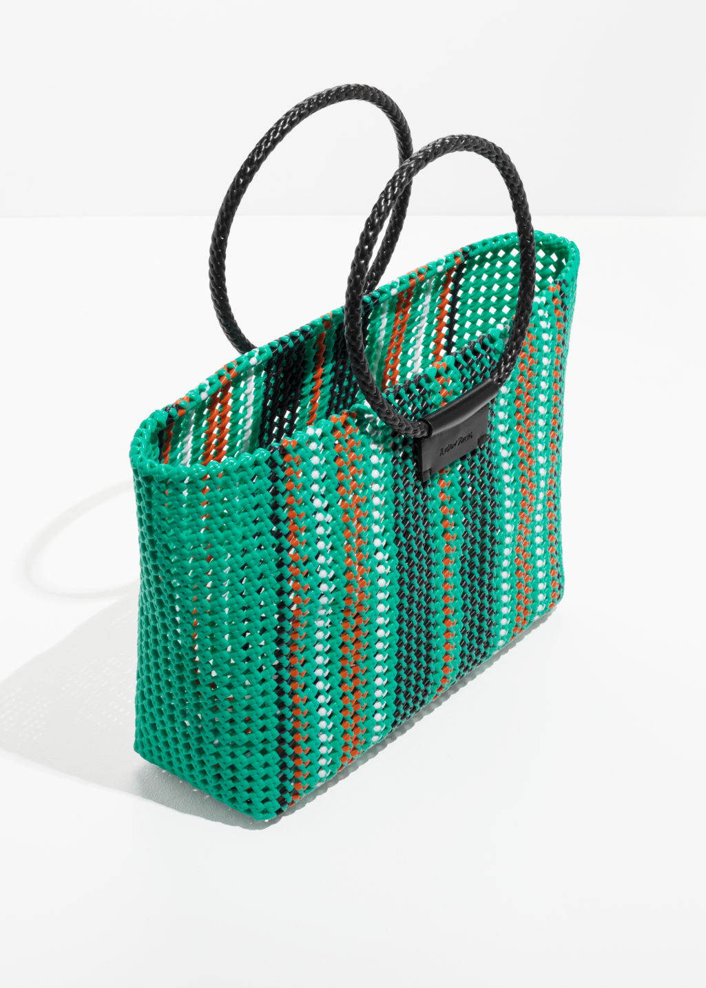 Back Image Of Stories Woven Plastic Tote In Green