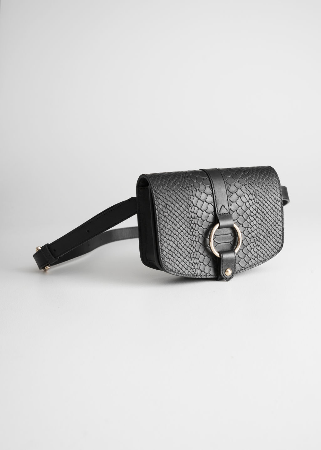 Front image of Stories leather snake textured beltbag in black