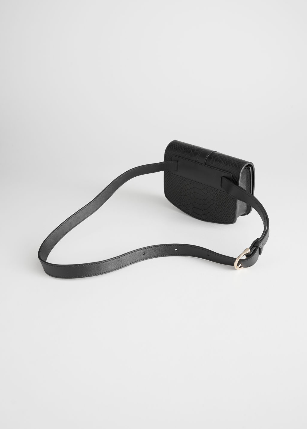Back image of Stories leather snake textured beltbag in black