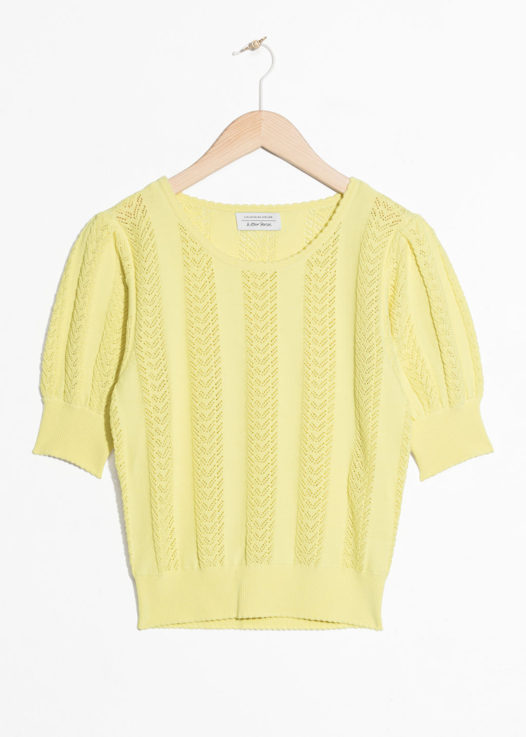 Front image of Stories eyelet knit top in yellow