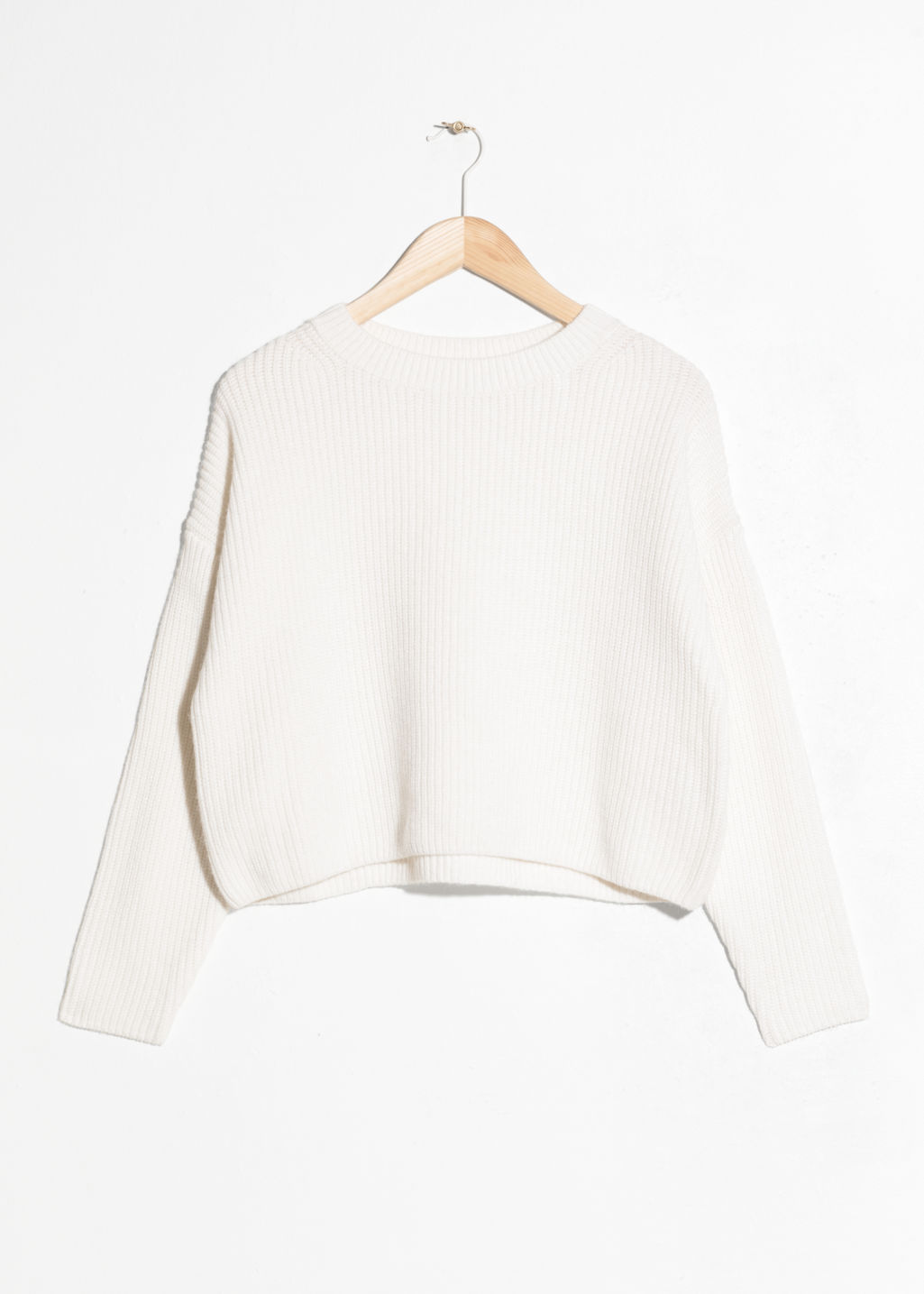 Front image of Stories cropped crewneck sweater in white