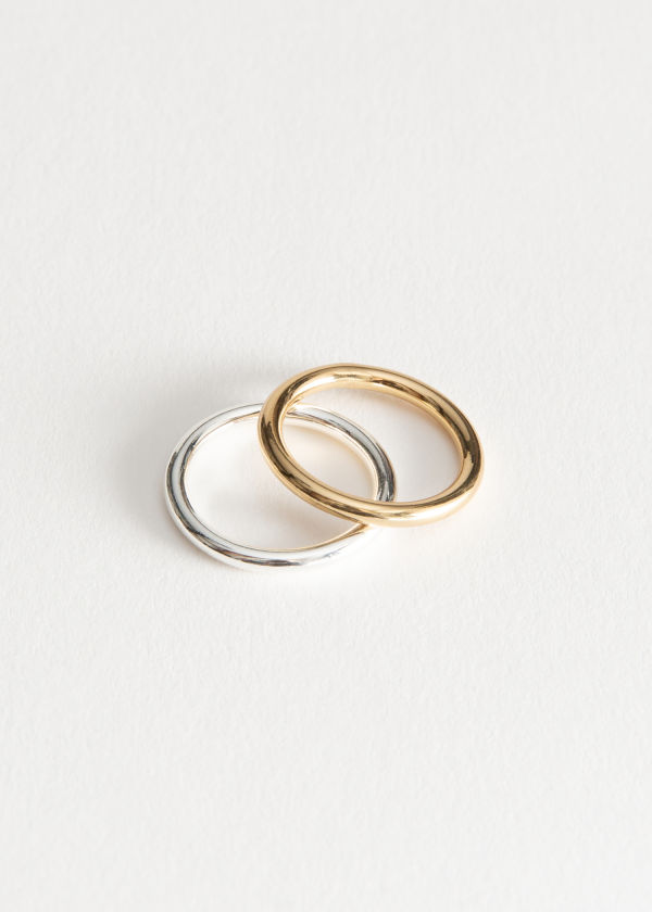 Front image of Stories duo metal ring set in gold
