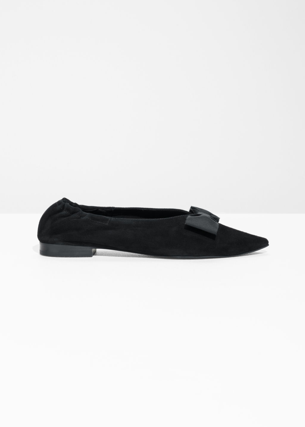 Front image of Stories pointy bow flats in black