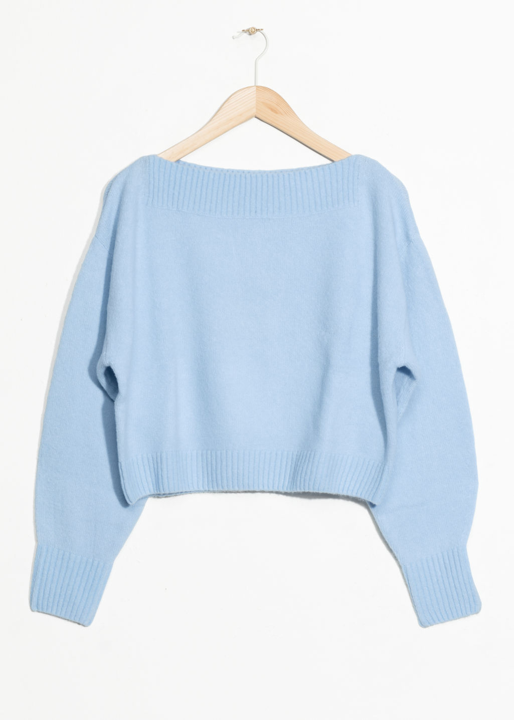 Front image of Stories cropped boatneck sweater in blue