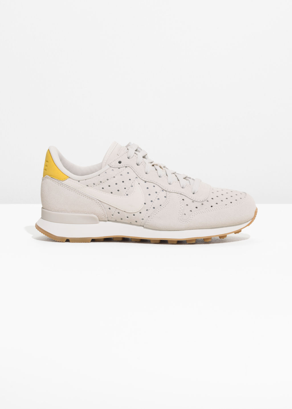 Front image of Stories nike internationalist premium in white
