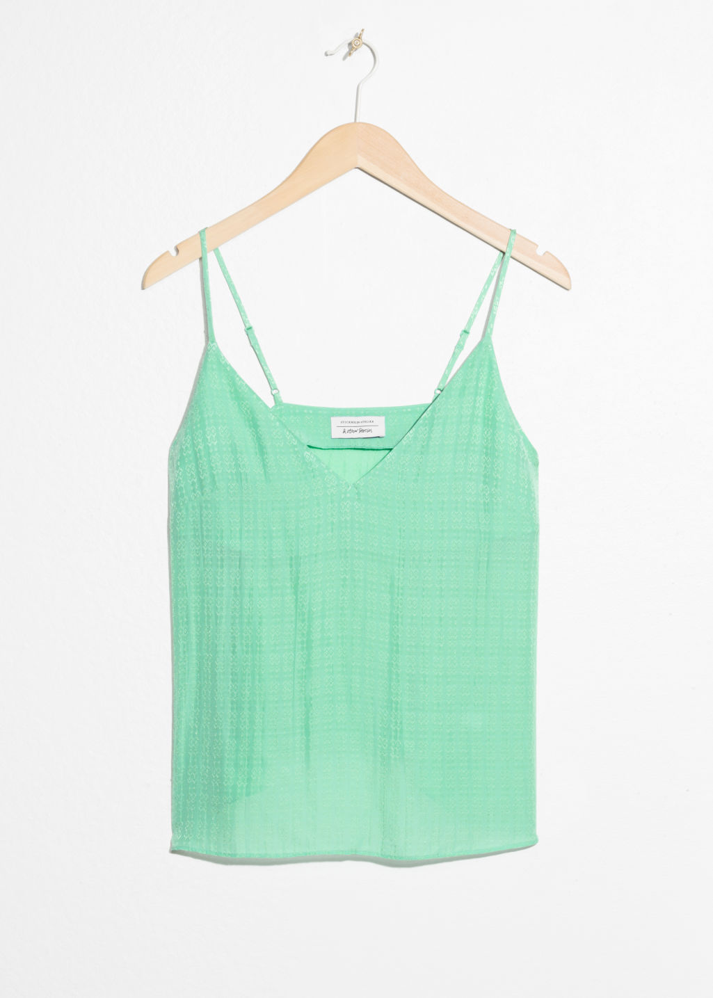 Front image of Stories v-neck jacquard tank in green