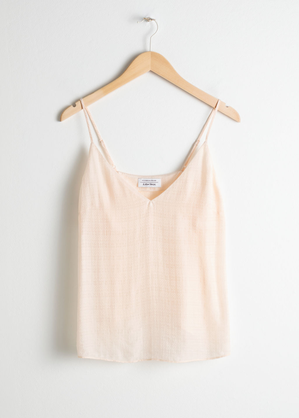 Front image of Stories v-neck jacquard tank in beige