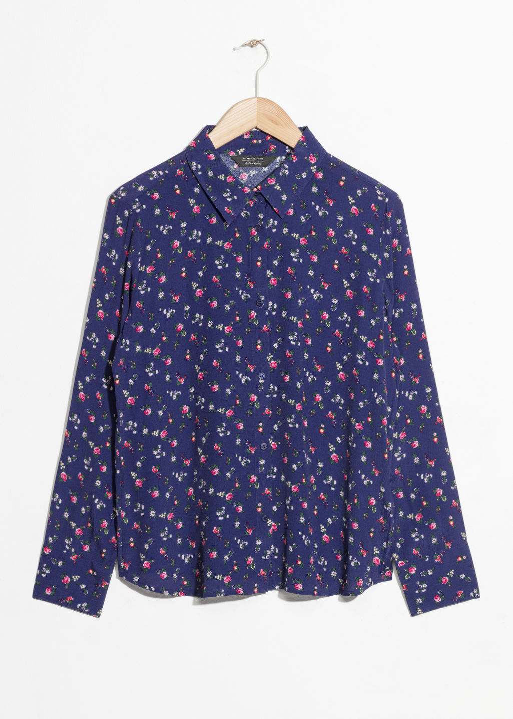 Front image of Stories collared button-down blouse in blue