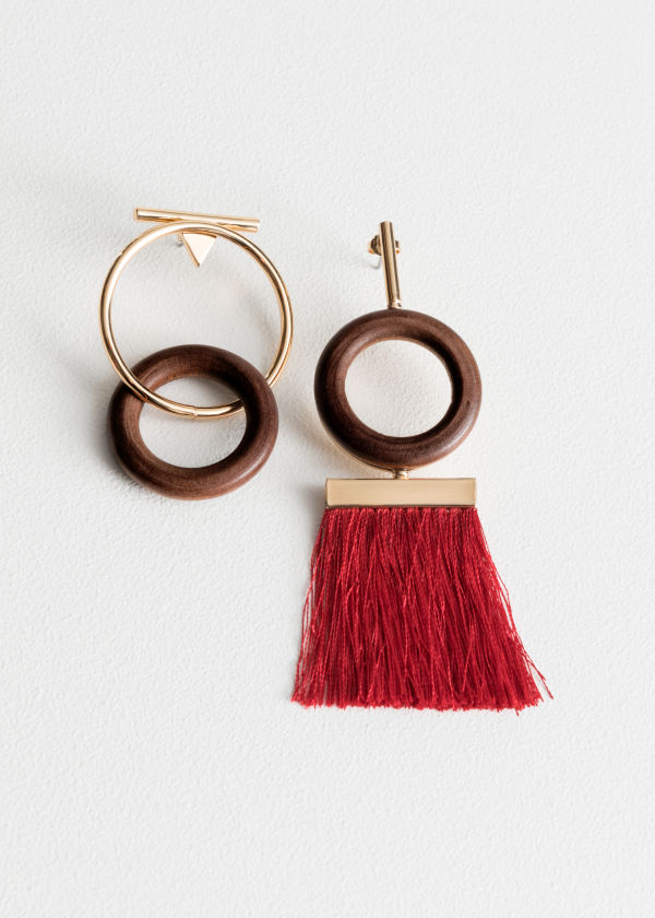 Front image of Stories wood o-ring mismatch earrings in red