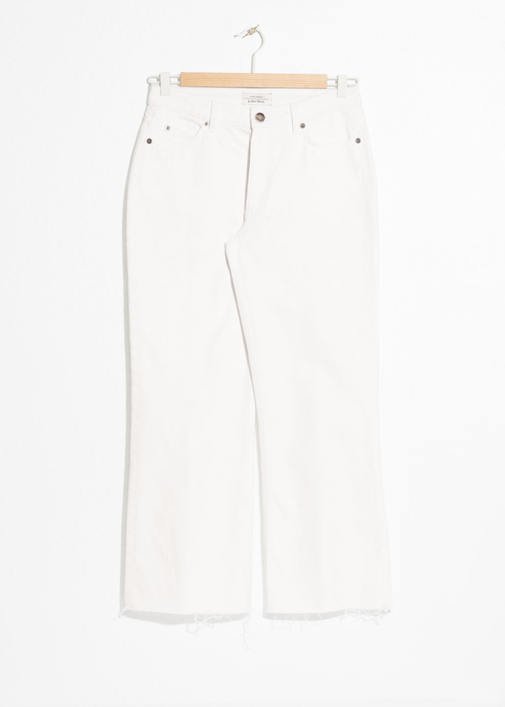 Front image of Stories cropped flare jeans in white