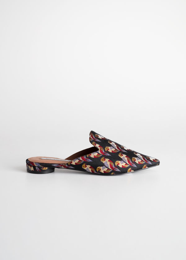 Front image of Stories tropical bird jacquard slip ons in black