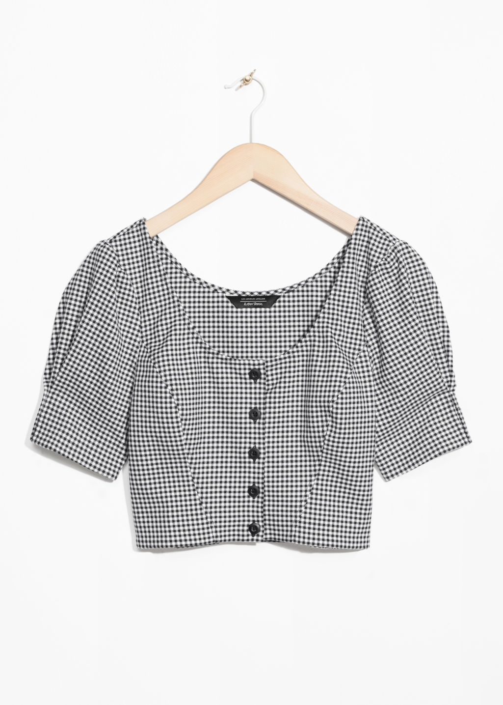 Front image of Stories gingham crop blouse in black