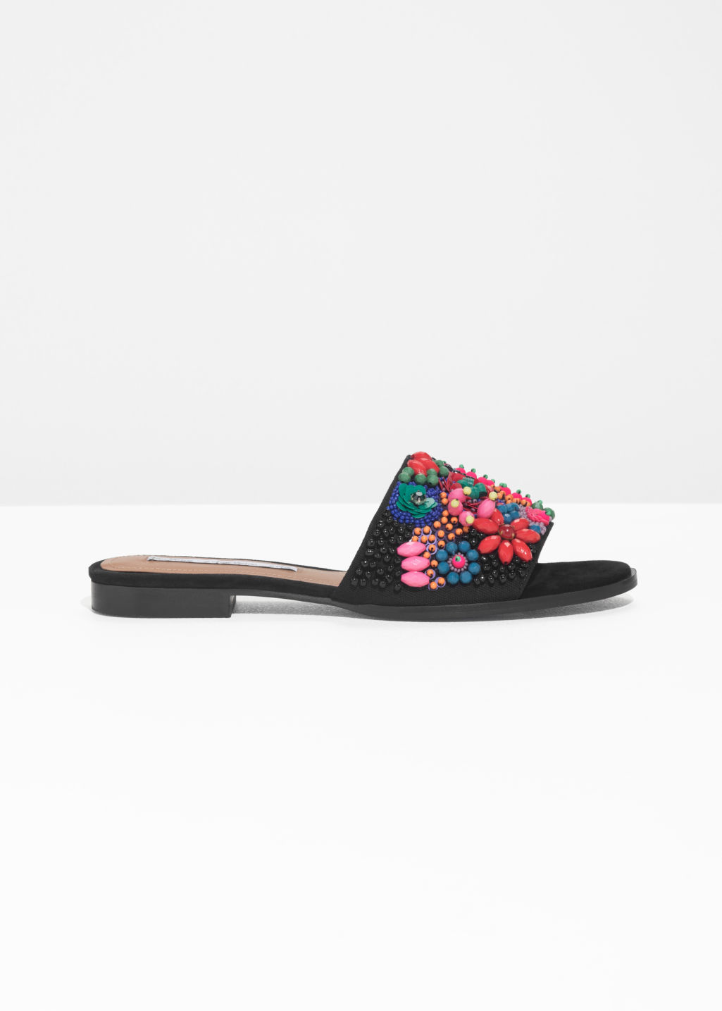 Front image of Stories embellished slip on sandals in black