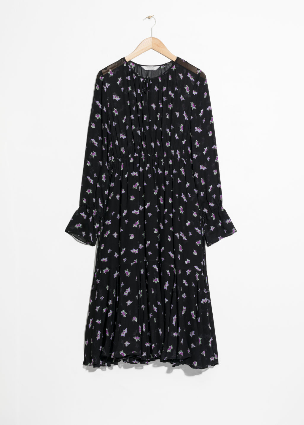 Front image of Stories midi tie neck dress in black