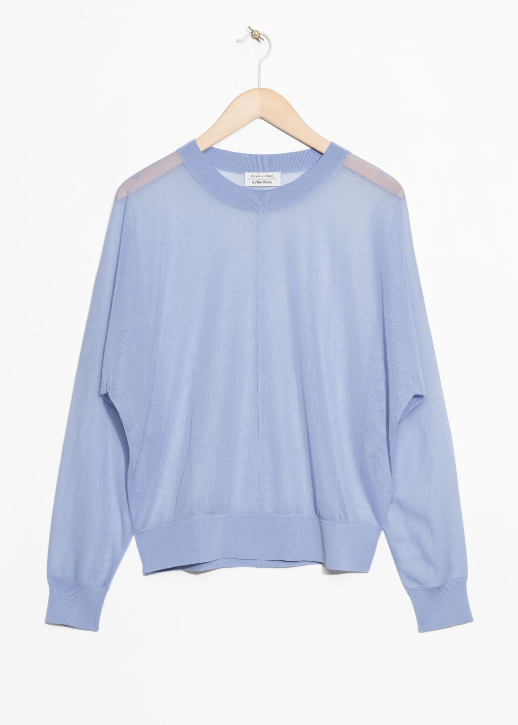 Front image of Stories sheer knit top  in blue