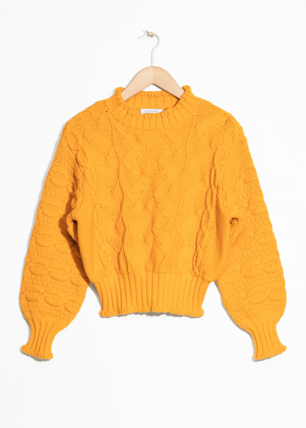Front image of Stories chunky knit sweater in yellow