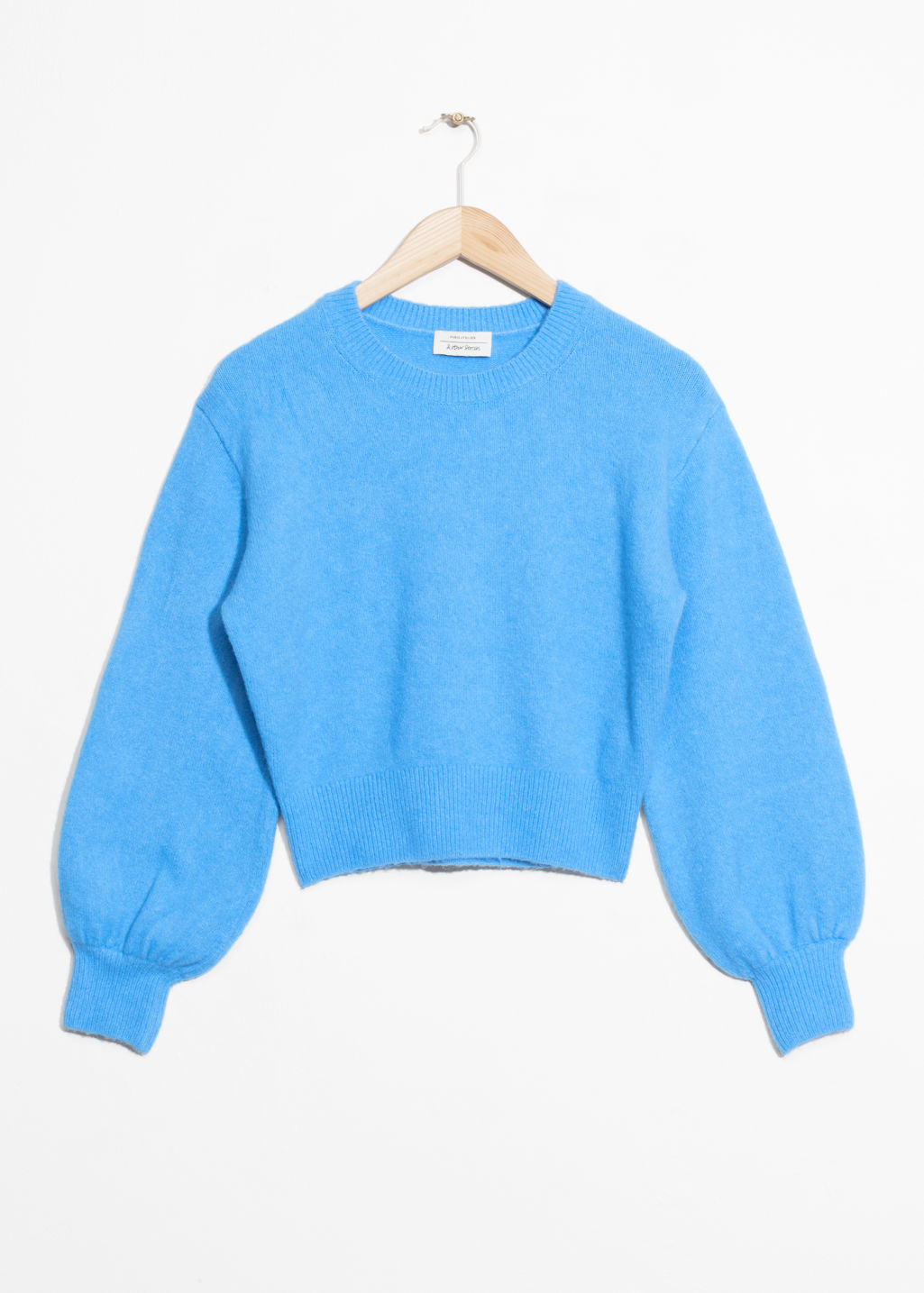 Front image of Stories cropped sweater in blue
