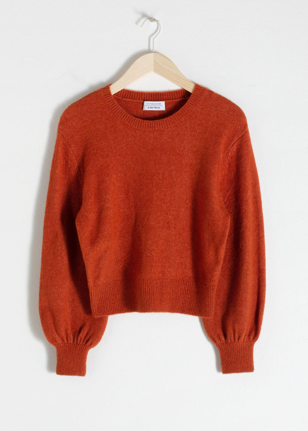 Front image of Stories cropped sweater in orange