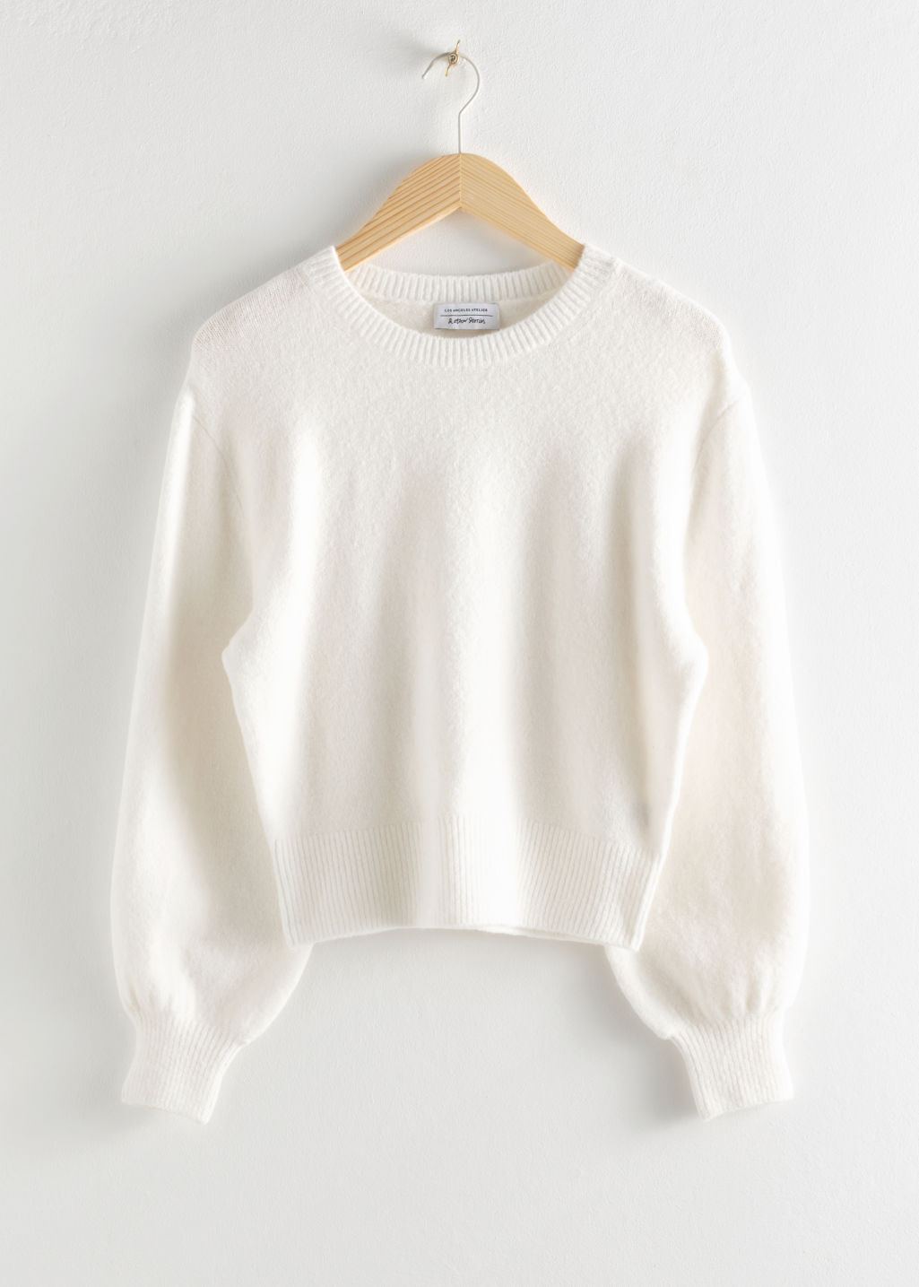 Front image of Stories cropped sweater in white