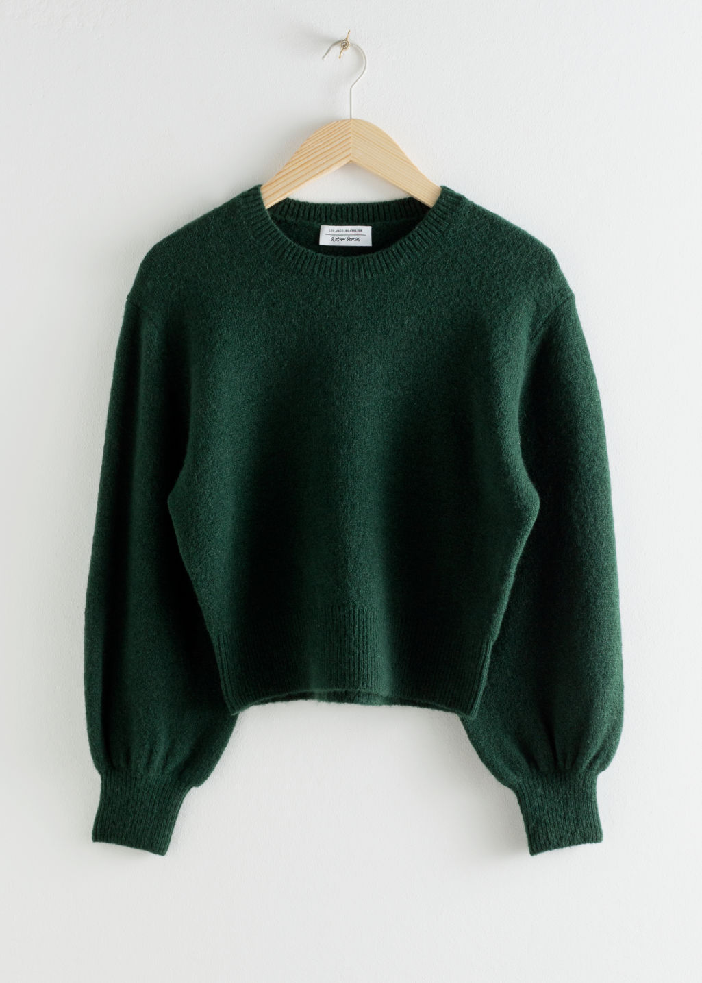 Front image of Stories cropped sweater in green