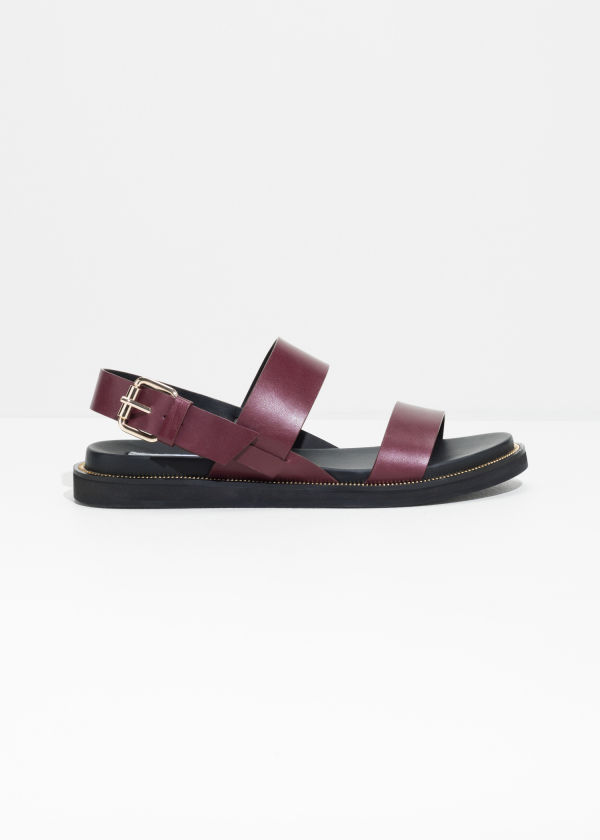 Front image of Stories diagonal strap leather sandals in red