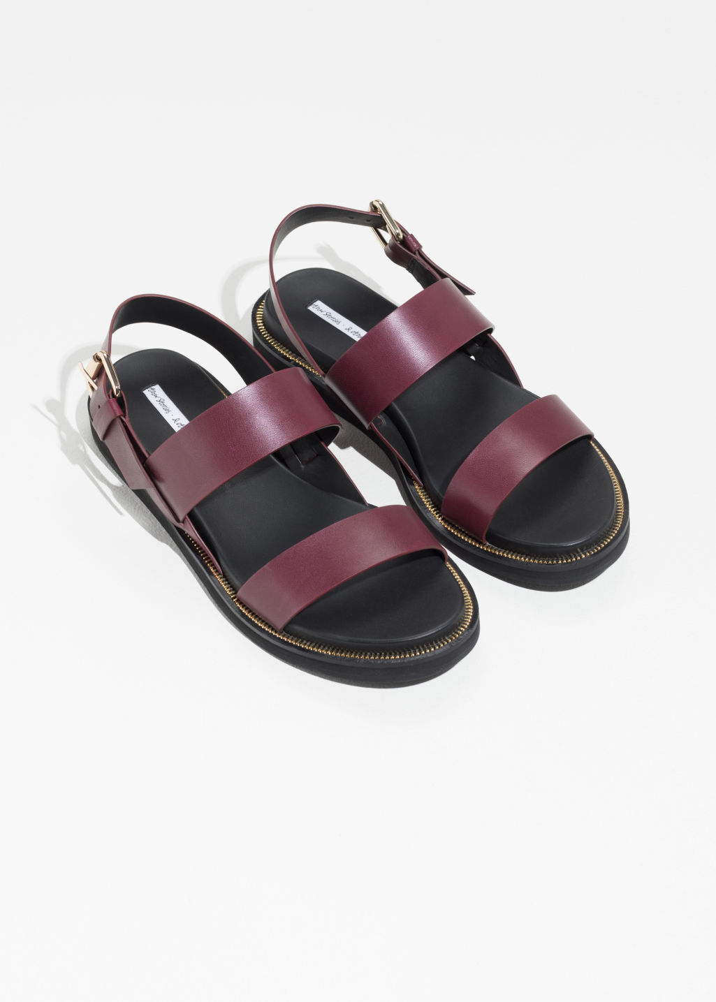 Back image of Stories diagonal strap leather sandals in red