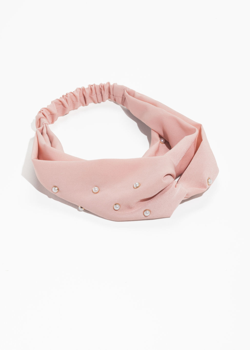 Front image of Stories pearl twist knot headband in beige