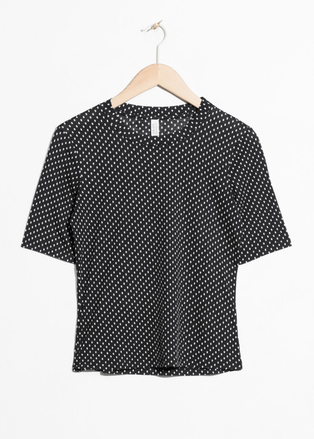 Front image of Stories cropped tee in black