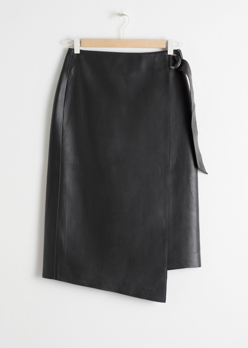 Front image of Stories asymmetric belted leather skirt  in black