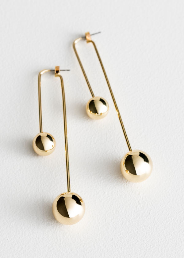 Front image of Stories duo sphere front back earrings in gold