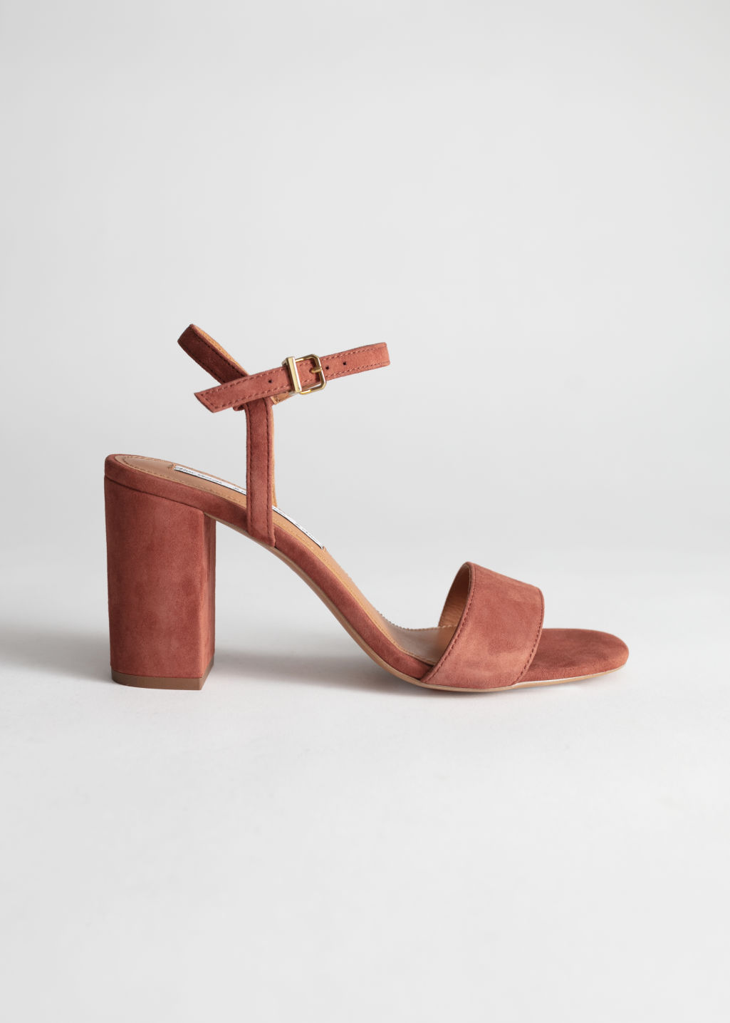 Front image of Stories strappy block heel sandals in orange