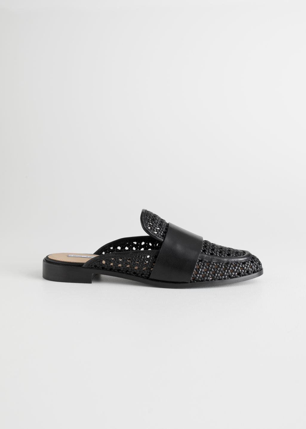 Front image of Stories pointed woven leather slip ons in black