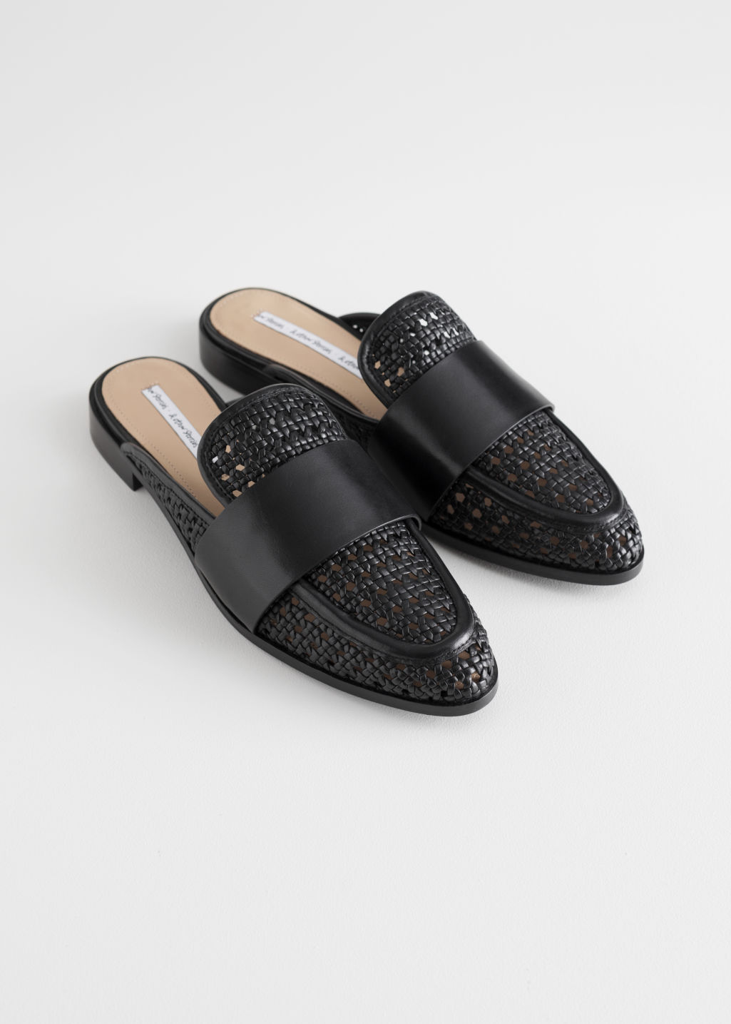 Back image of Stories pointed woven leather slip ons in black
