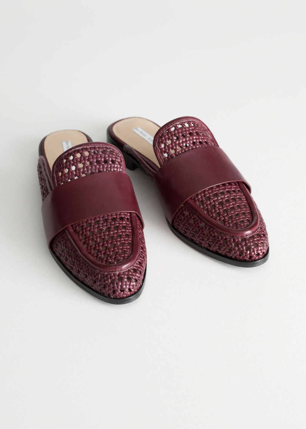 Back image of Stories pointed woven leather slip ons in red
