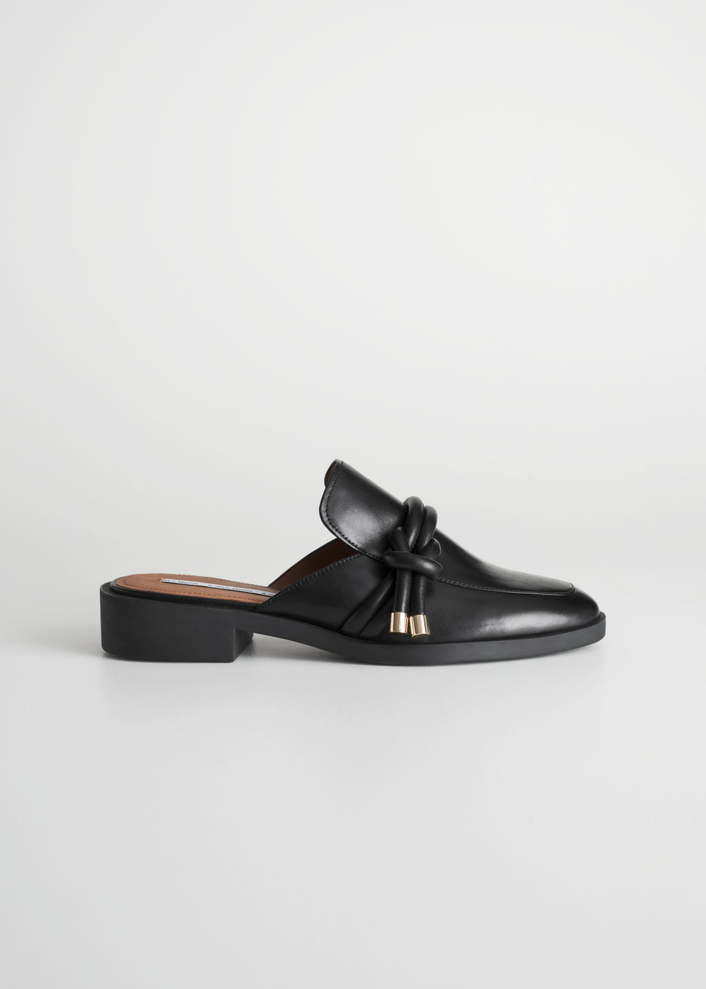 Front image of Stories reef knot loafers in black