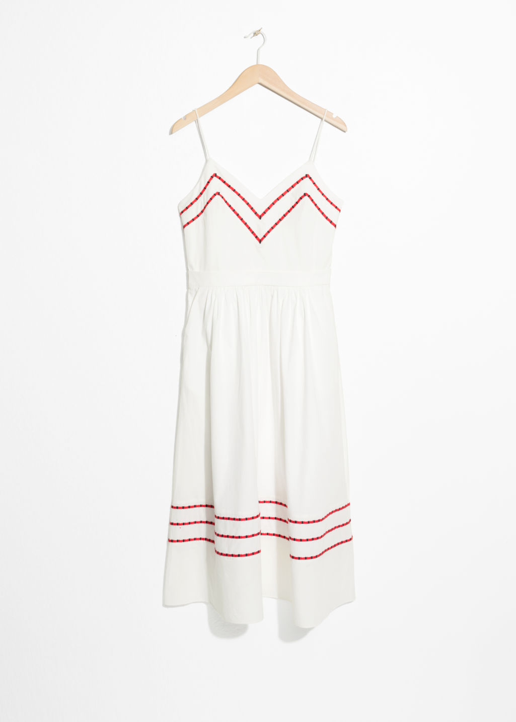 Front image of Stories chevron a-line cotton dress in white