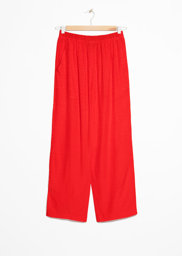 Front image of Stories jacquard dot print trousers in red