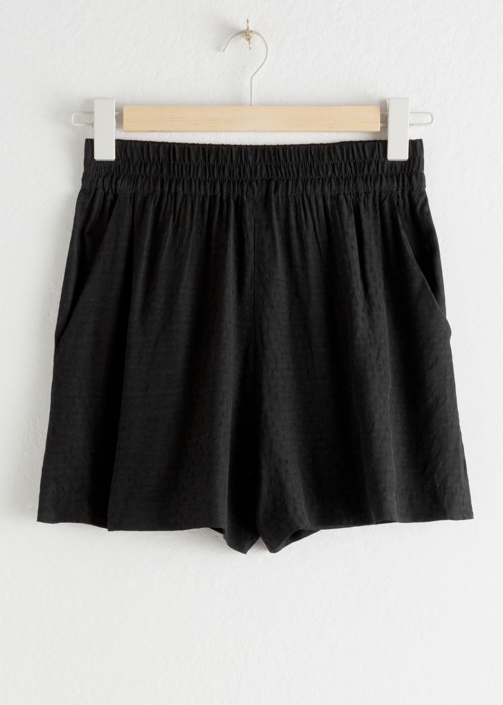 Front image of Stories high waisted elasticated shorts in black
