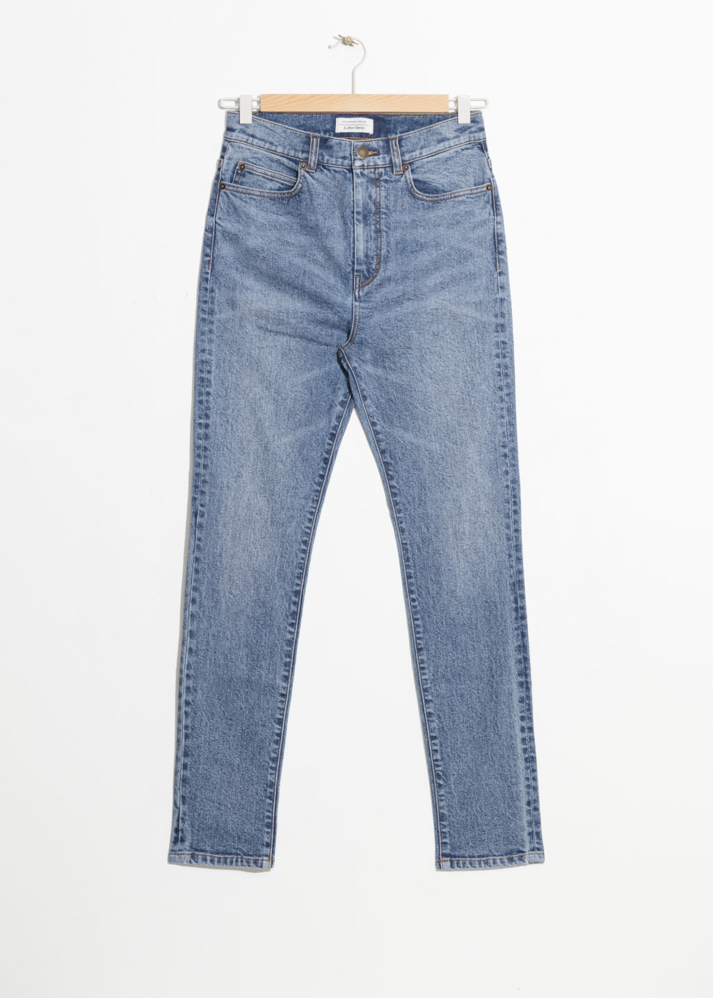 Front image of Stories high rise slim jeans in blue