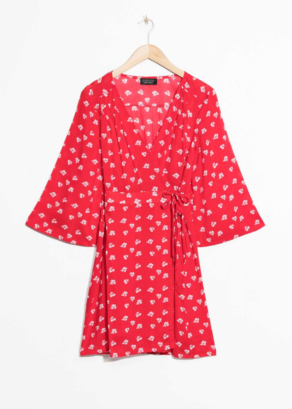 Front image of Stories flare sleeve wrap dress in red