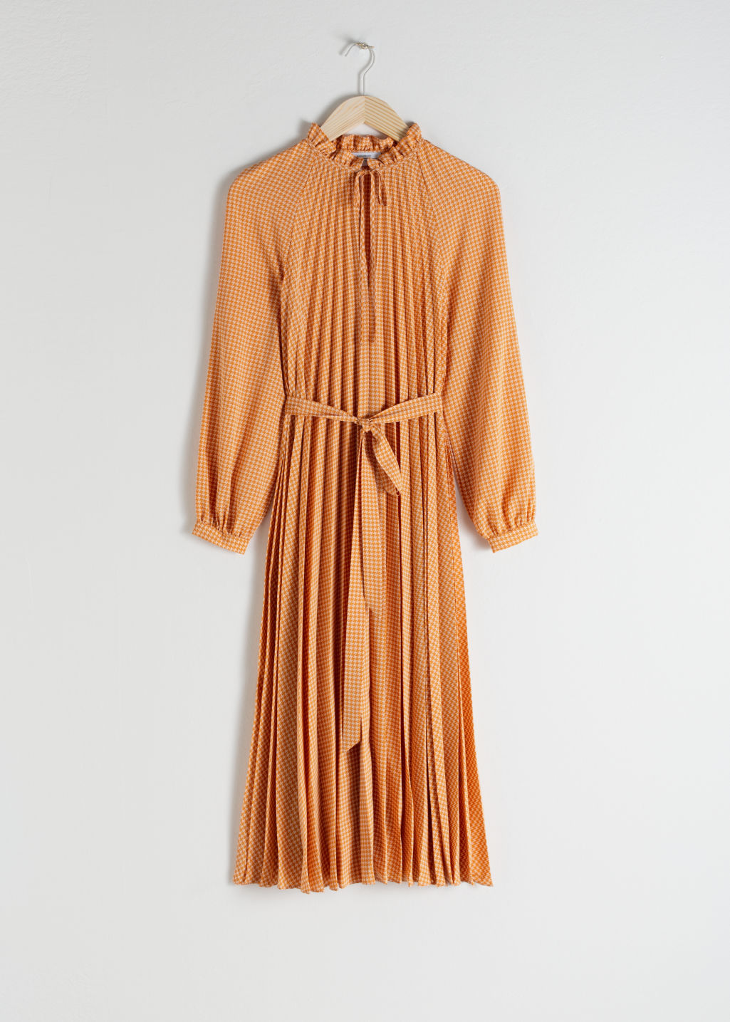 Front image of Stories pleated midi dress in yellow