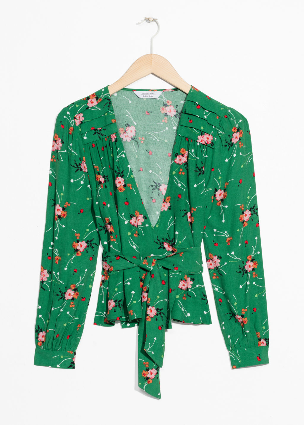 Front image of Stories cropped floral wrap blouse  in green